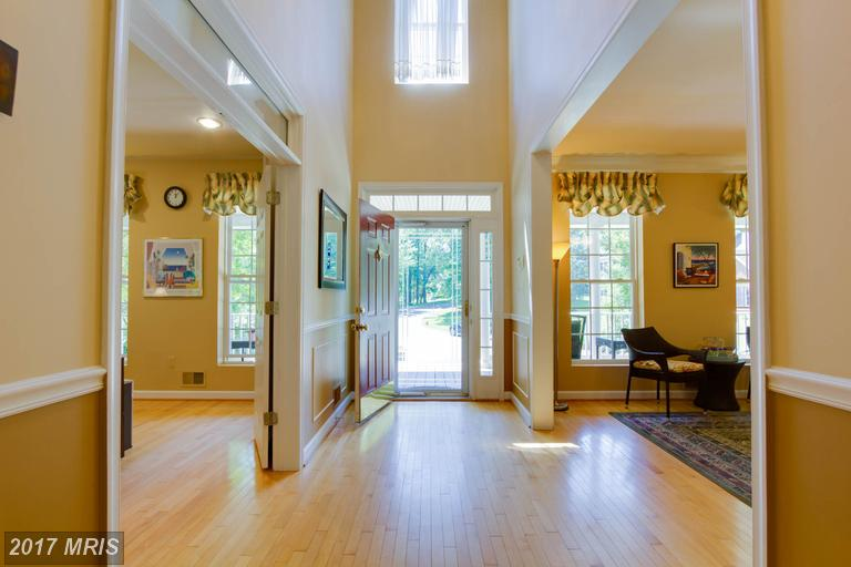 This grand, two story foyer will greet your guests. Enjoy the bright windows around the door and detailed molding.