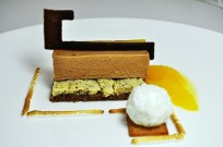Tanariva chocolate mousse, vanilla gelato, feuilletine, hazelnut cake, cocoa tuille and citrus sauce