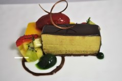 Pistachio and chocolate terrine passion fruit bar, raspberry sorbet, tropical fruit and mint