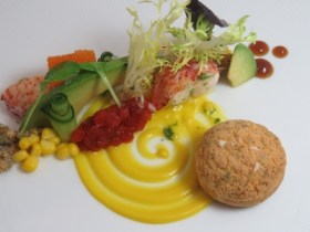 """Lobster salad with lobster """"roll,"""" sweet corn pudding, avocado, apple, cucumber, tomato jam and yuzu dressing"""