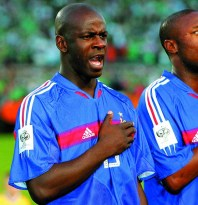 <i>Lilian Thuram et William Gallas pendant La Marseillaise</i>, 2005. © Neal Marchand/ ICON SPORT