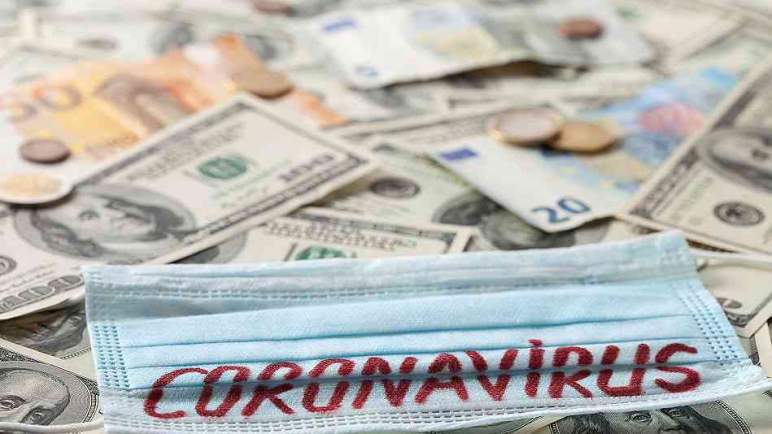 العلماء يحددون مدة عيش فيروس (كورونا) على النقود