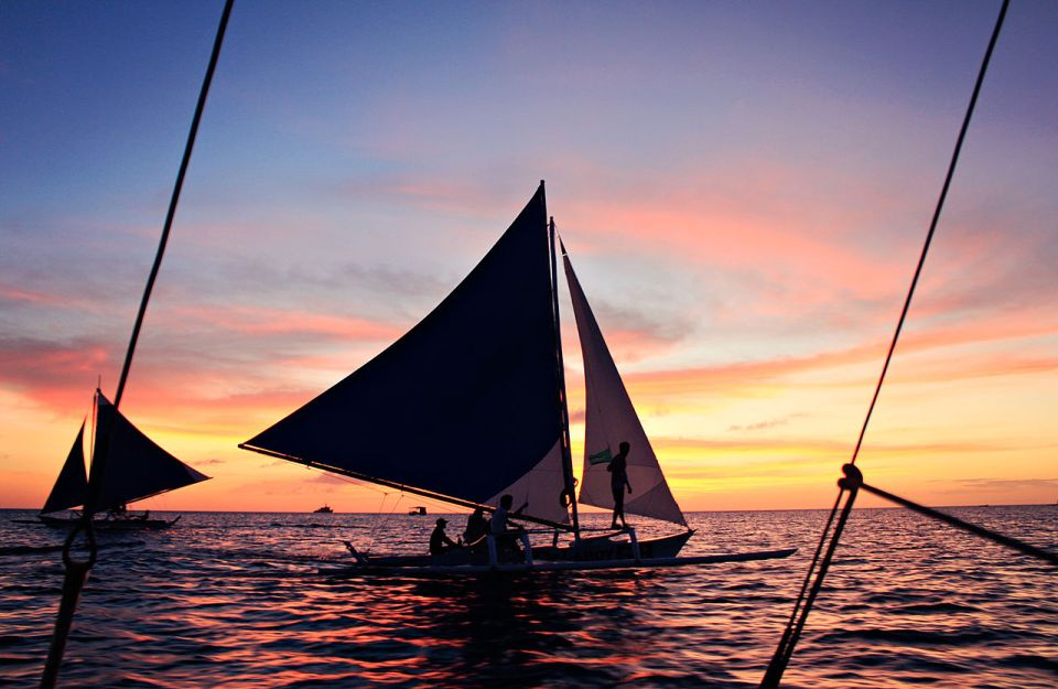 A modern version of an ancient paraw double outrigger sailboat in the Philippines
