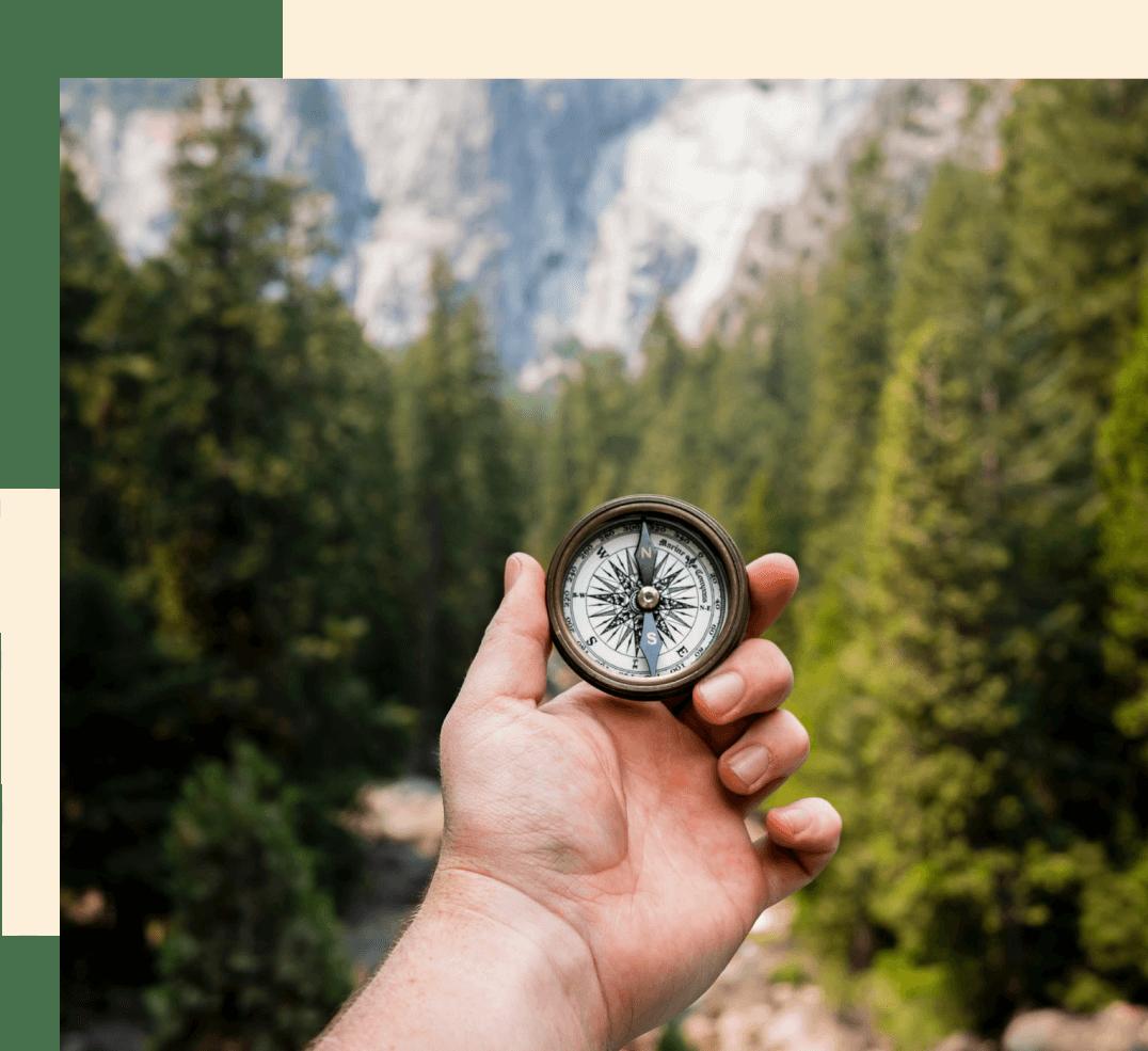 Man hand holding a compass