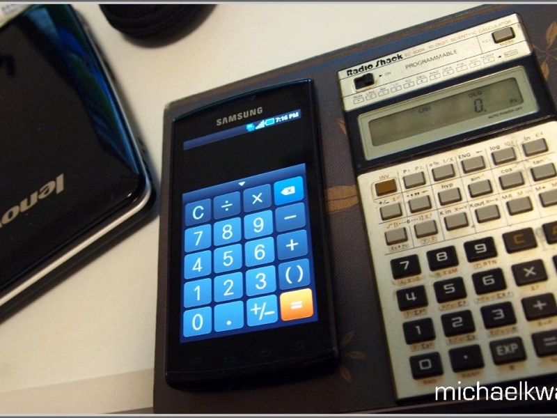 Two scientific pocket calculators on a desk.