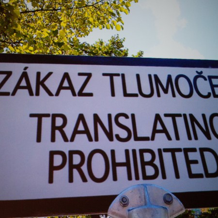 "Sign reading ""Translating prohibited"" in English and Slovene (?)"