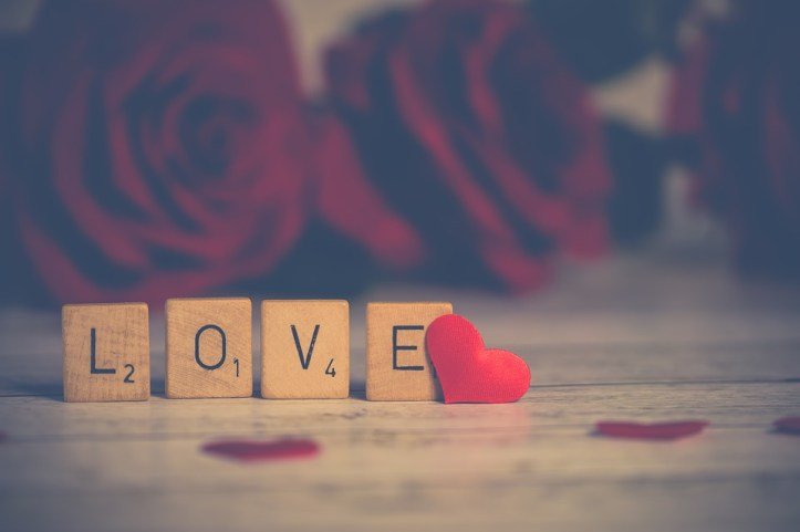 Scrabble letters forming the word love