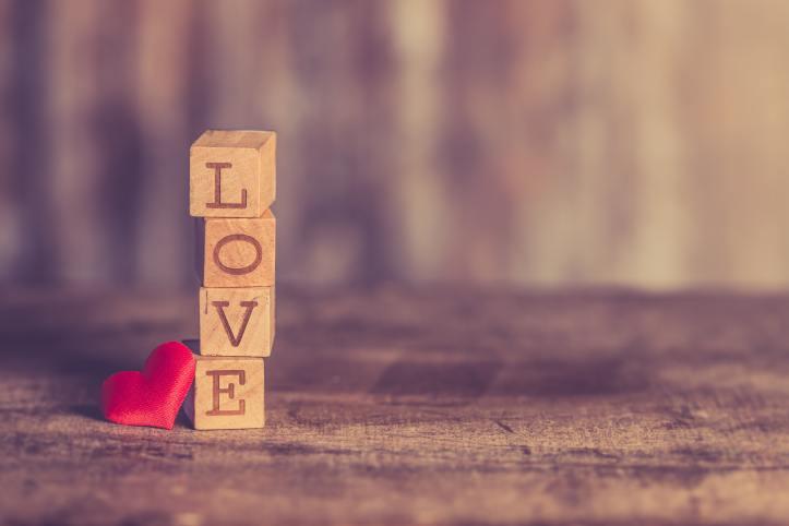 Stalk of wooden blocks, spelling love