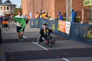 Handcycle with guide running beside