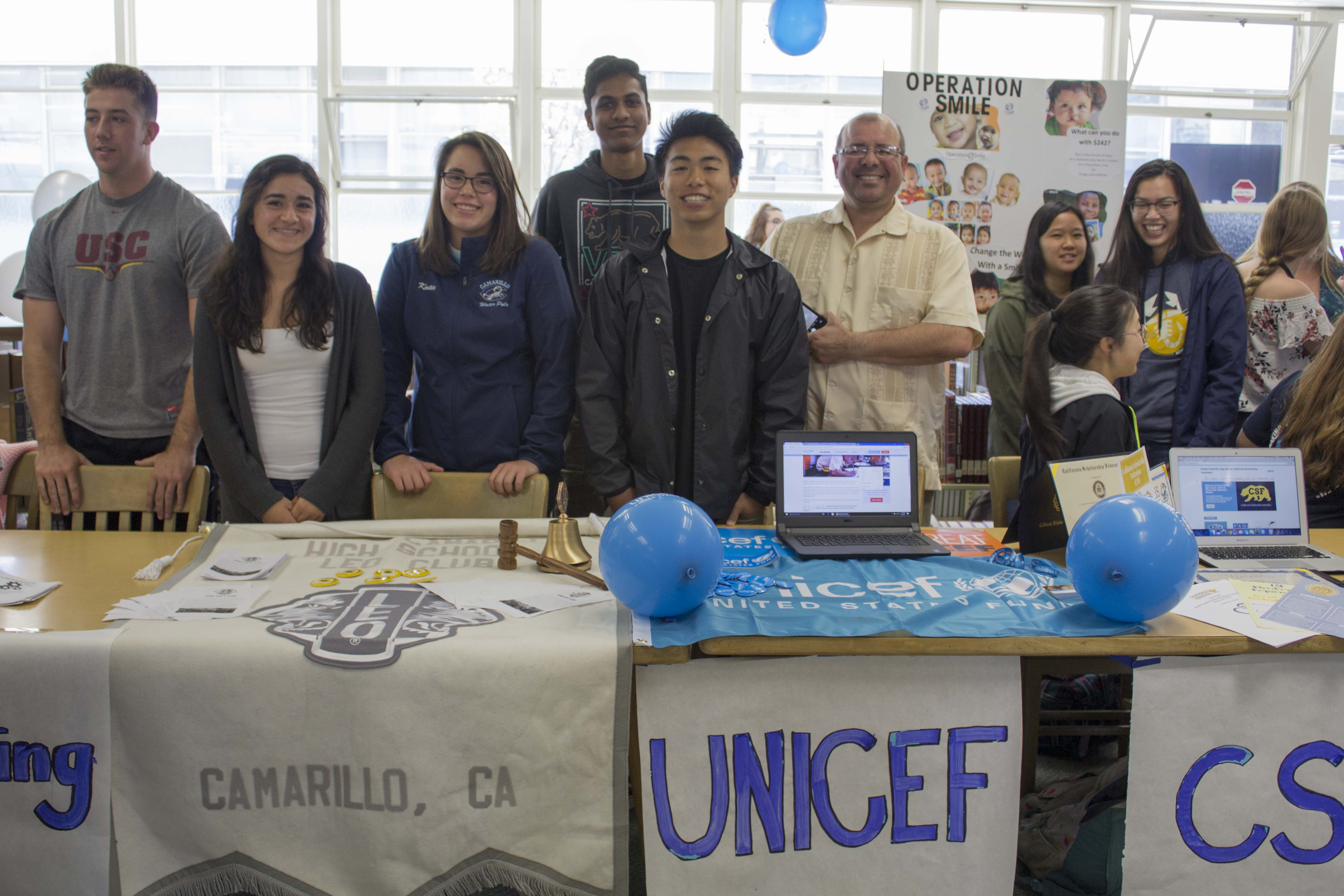 Andrea Banales and Katie Rodriguez, seniors, representing Leo's Club and Aditya Sunkara, Ben Abutin, juniors, and Mr. Jesus Duran representing UNICEF.