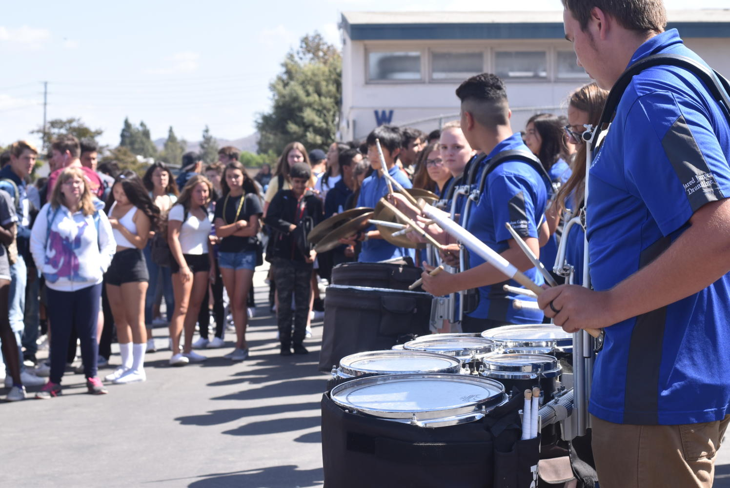 Cam High's marching band plays drums outside of the gym prior to the rally.