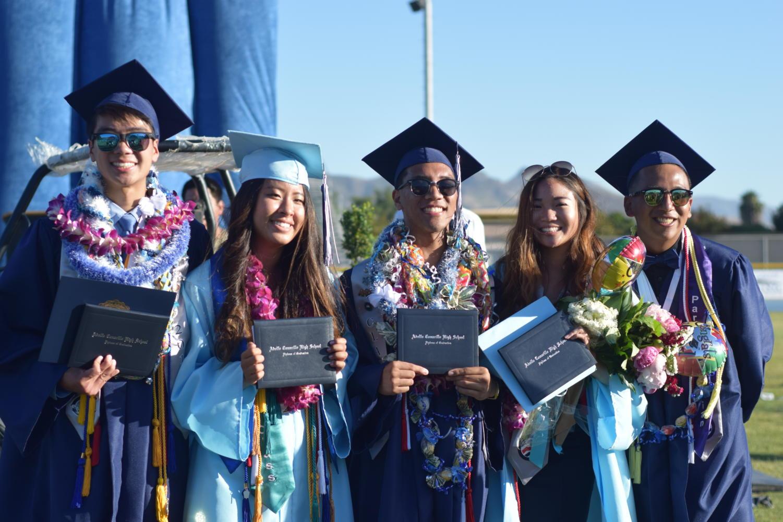 Cam High alumni Brandon Fujii, Joyce Seok, Joseph Cachin, Shing Ou, and Ohtli Garcia pose with their diplomas after the Class of 2017's graduation.