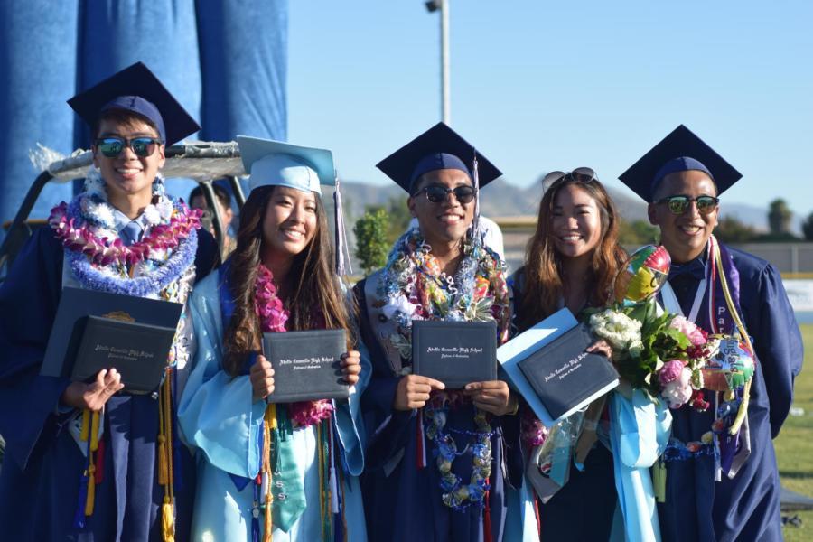 Cam+High+alumni+Brandon+Fujii%2C+Joyce+Seok%2C+Joseph+Cachin%2C+Shing+Ou%2C+and+Ohtli+Garcia+pose+with+their+diplomas+after+the+Class+of+2017%27s+graduation.
