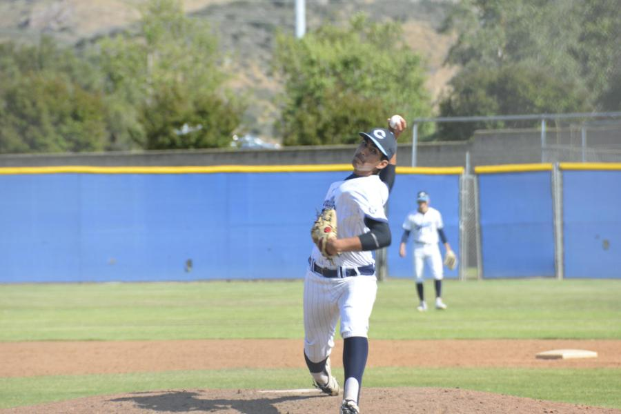 Photo+by%3A+Gabi+Jose+%0APitcher+and+senior+Gabe+Baldovino+throwing+a+pitch+against+Sierra+Canyon.