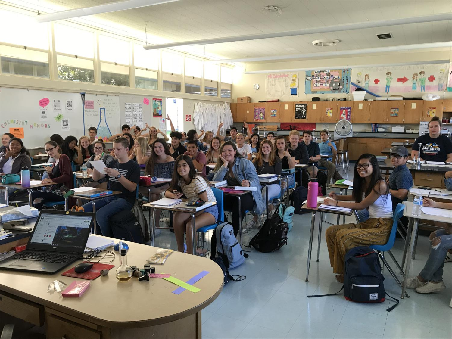 Ms. Su's chemistry honors class contains over the maximum amount of students allowed by the district.