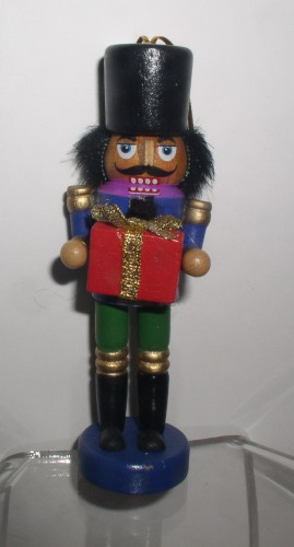 Nutcracker Holding Present 4 Inches Tall Christmas Wood