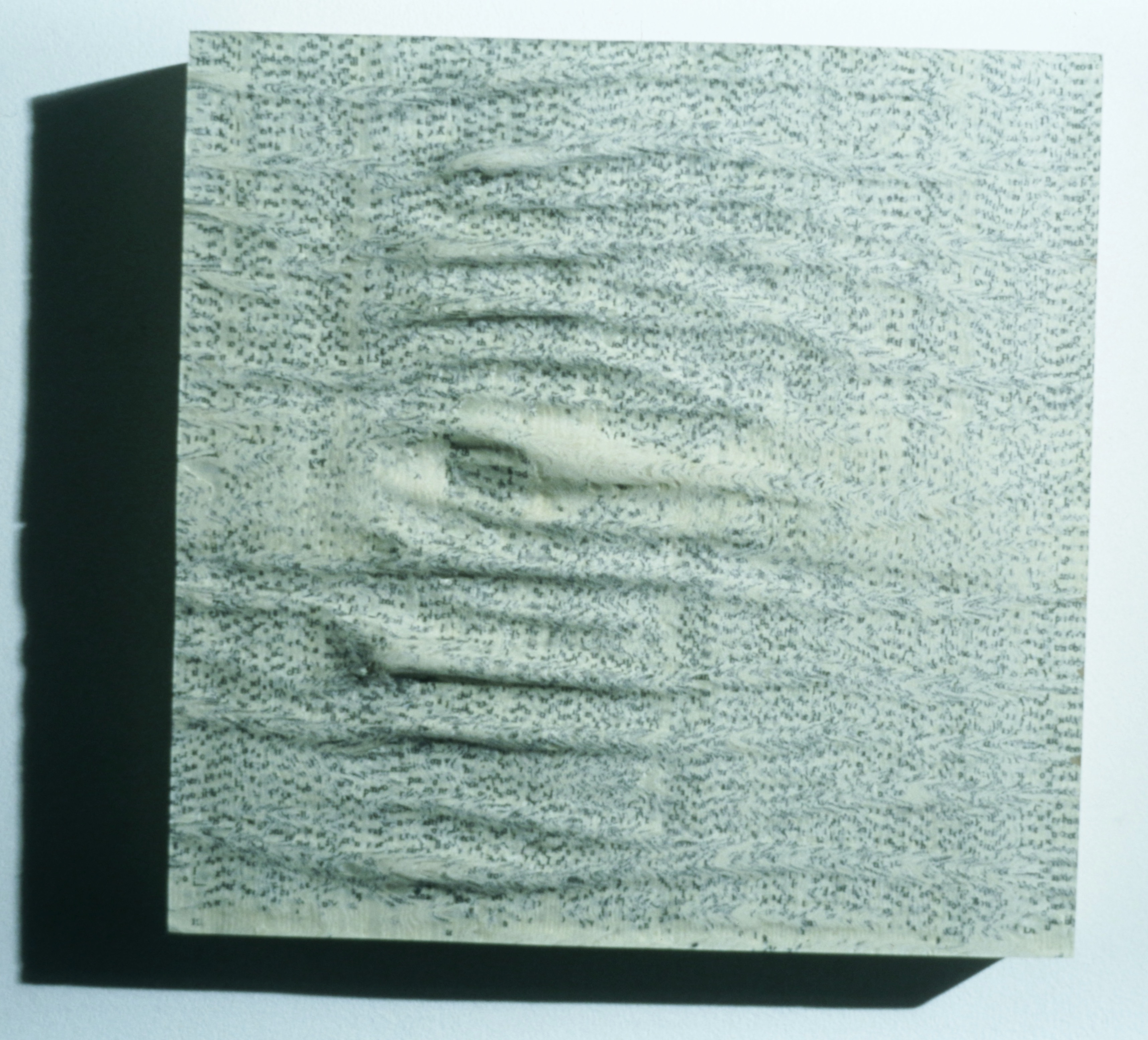 "Misreadings: one novel on wood (1996) 12"" x 12"" x 2.5"""