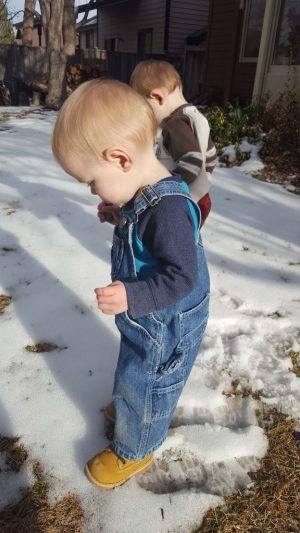 Kids in backyard in snow.