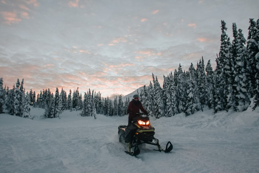 Snowmobiling in the backcountry on Rainbow Mountain