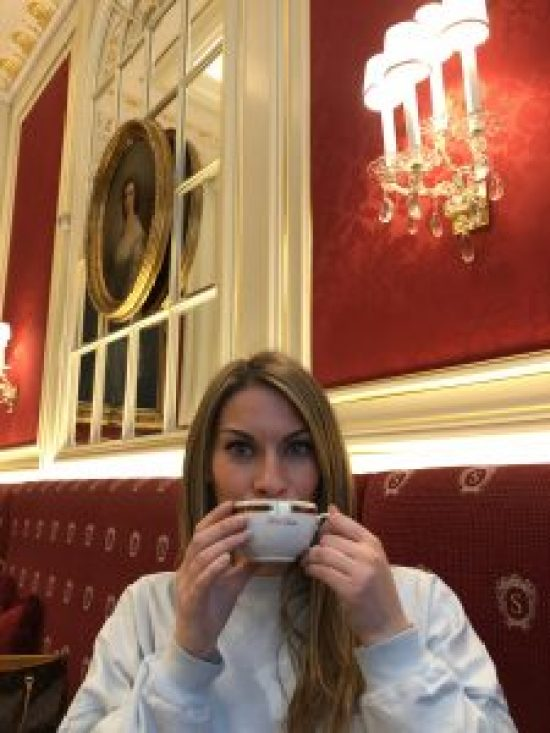 Drinking coffee at Cafe Sacher, Vienna Austria