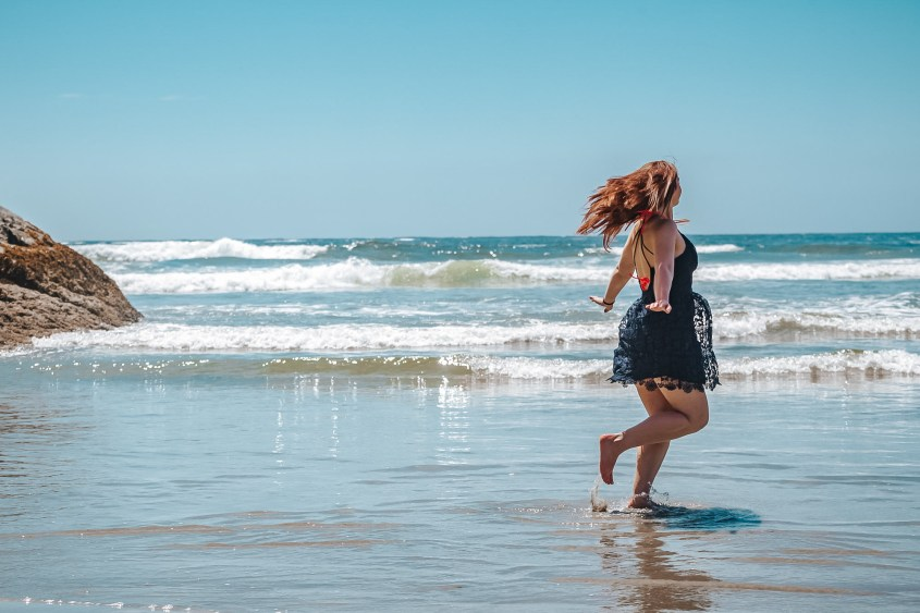 Twirling around in the shallow ocean at Chesterman Beach - one of the top things to do in Tofino