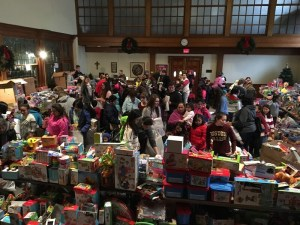 From 9 to noon, families moved through the hall under the helpful eye of a volunteer escort, who helped each child pick out three toys.