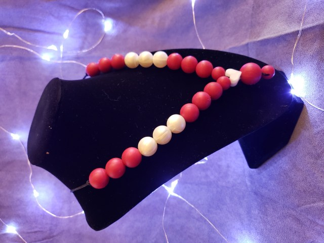 Necklace with metallic red and white beads