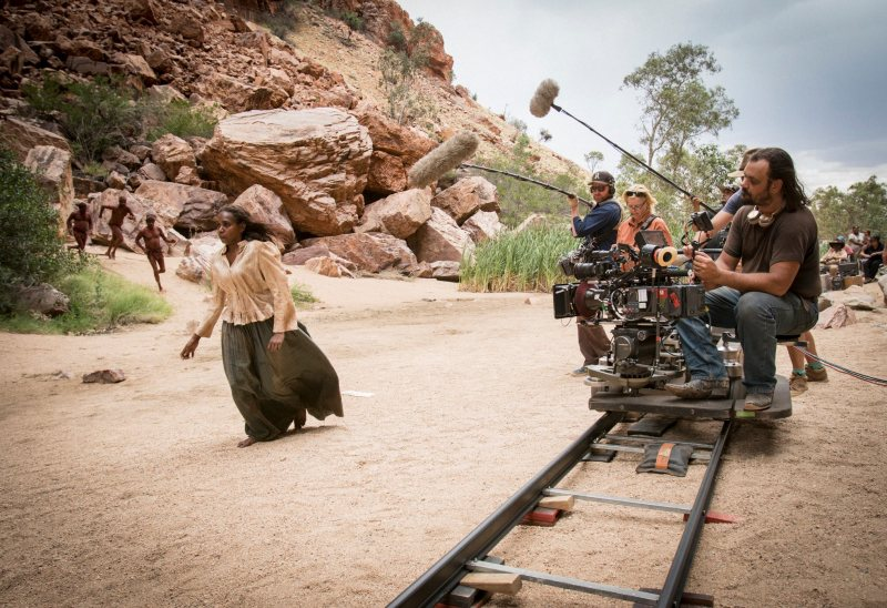 Warwick Thornton (sitting) and crew filming 'Sweet Country' on location at Simpsons Gap near Alice Springs - PHOTO Mark Rogers
