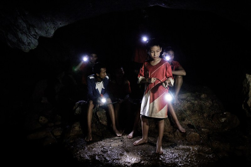 Movie - The Cave (2019) - A Thai boys soccer team is trapped in a cave while rescue workers scramble to save them.