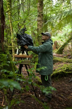 Peter Nearhos ACS behind the camera in the Tasmanian wilderness - PHOTO Damon Heather