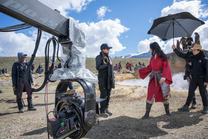 Filming 'Mulan' on location, director Niki Caro at centre - PHOTO Walt Disney Pictures