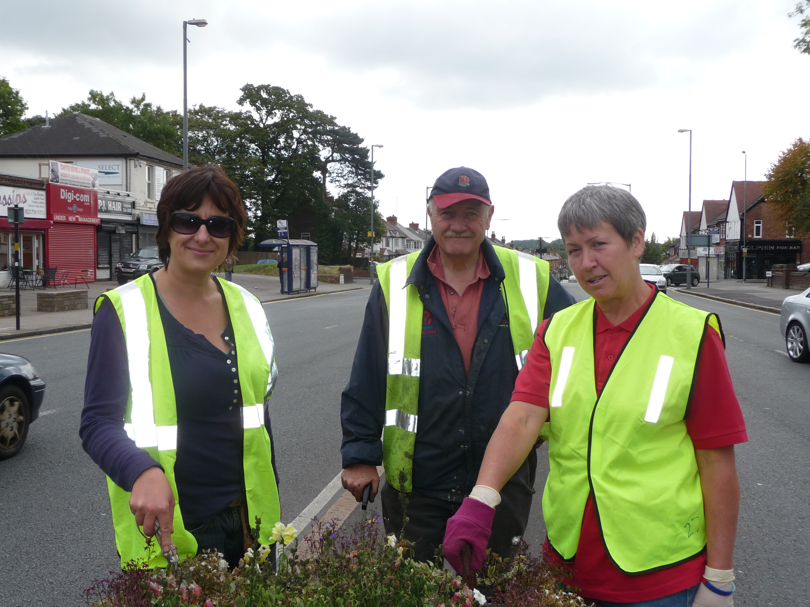 Weeding the planters on the Warwick Road, Acocks Green