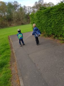 Youngest on scooter and Eldest walking