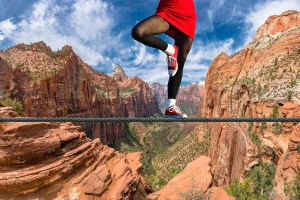 Person on a tight-rope over a canyon