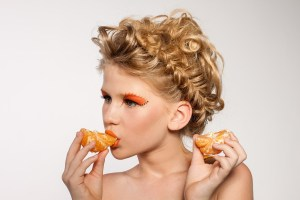 Woman eating orange pieces