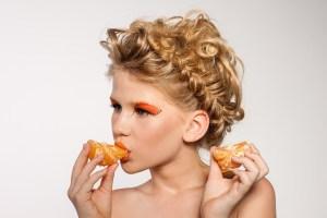 Woman eating orange pieces