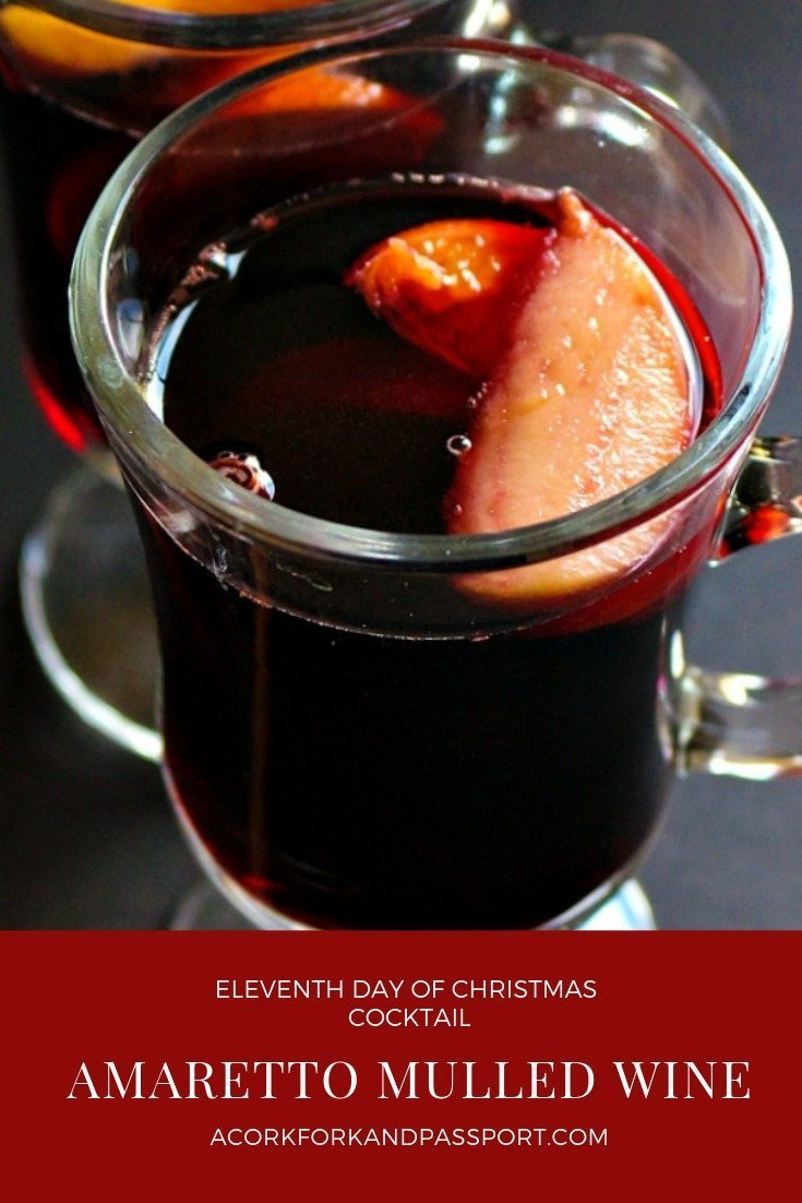 Amaretto Mulled Wine - Piping hot wine made with Amaretto liqueur,  fresh fruit and juices, and holiday spices.