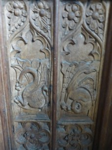 St Eval: rood carvings of a dragon and wyvern