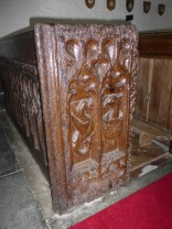 St Eval: a wyvern on a bench end