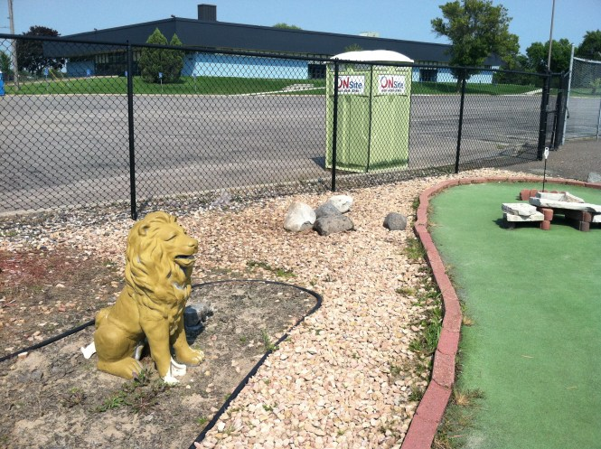 Lion and Port-a-Pot greet you at Hole 18