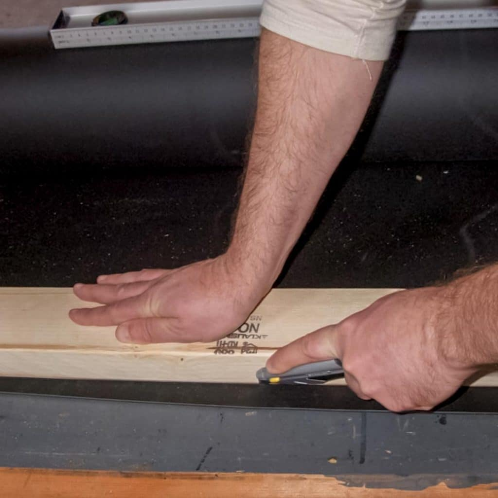 Soundproofing A Garage Use A Straight Edge And Utility Knife To Cut The Barrier To The Size You Need
