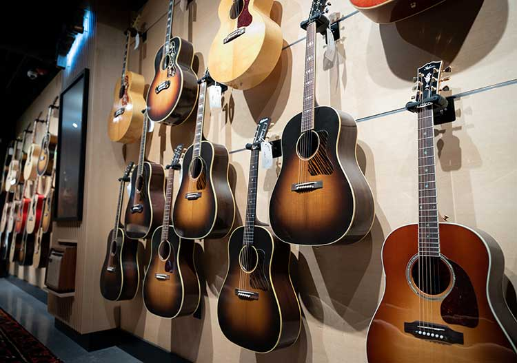 Closeup of acoustic guitars in the acoustic room at the Gibson Garage in Nashville