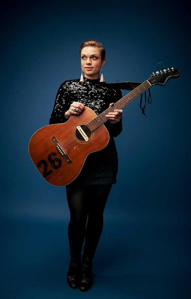 Nashville guitarist Lillie Mae against a blue background