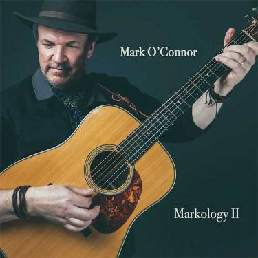 Musician Mark O'Connor holds his acoustic guitar on the cover of his album Markology II