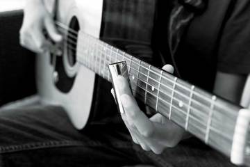 Acoustic guitar played with a slide