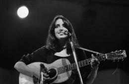 joan baez playing acoustic guitar