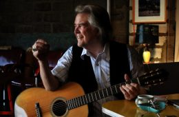guy clark with acoustic guitar
