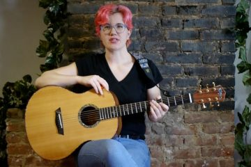 Acoustic Guitar Lesson B Major Chord How To Play Woman Guitarist Plays E-B Chords Kate Koenig Video Still video lesson