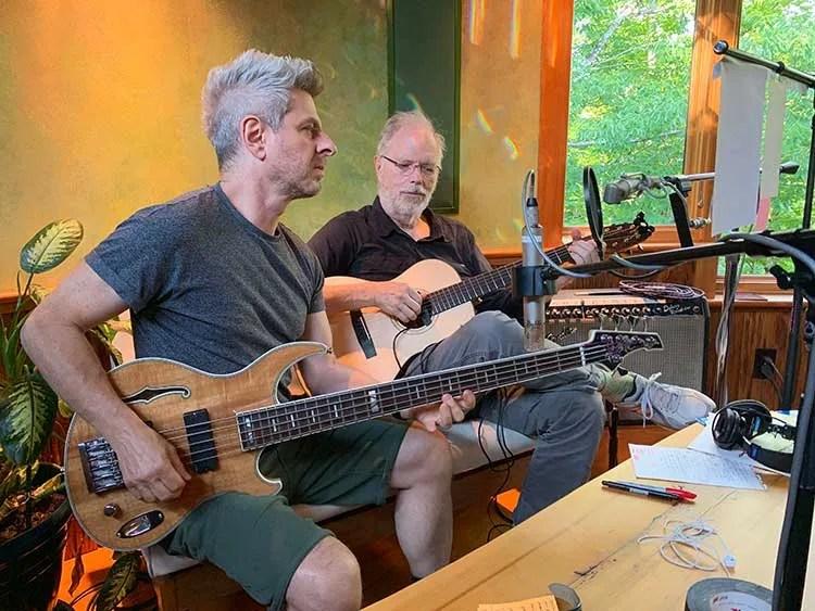 Bassist Mike Gordon and guitarist Leo Kottke recording tracks in Kottke's home studio