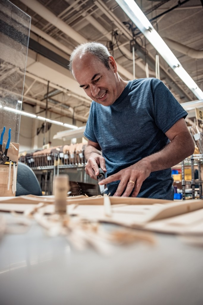 Thomas Ripsam working on scalloped braces in the Martin factory